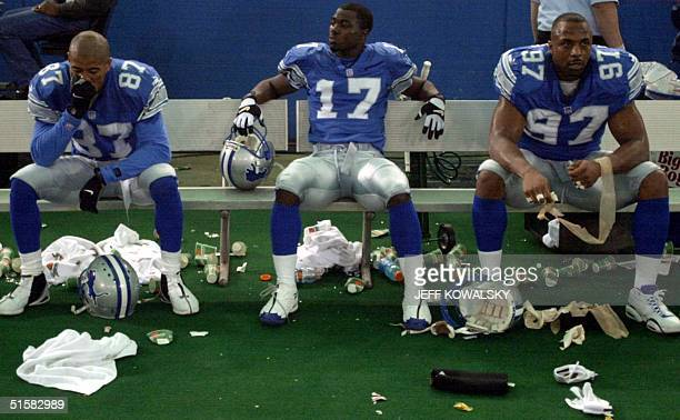 Detroit Lions' Johnnie Morton Larry Foster and Tracy Scroggins sit dejected on the bench after their 2320 loss to the Chicago Bears 24 December 2000...