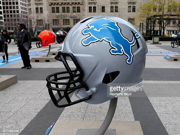 Detroit Lions NFL football helmet is on display in Pioneer Court to commemorate the NFL Draft 2015 in Chicago on April 30 2015 in Chicago Illinois