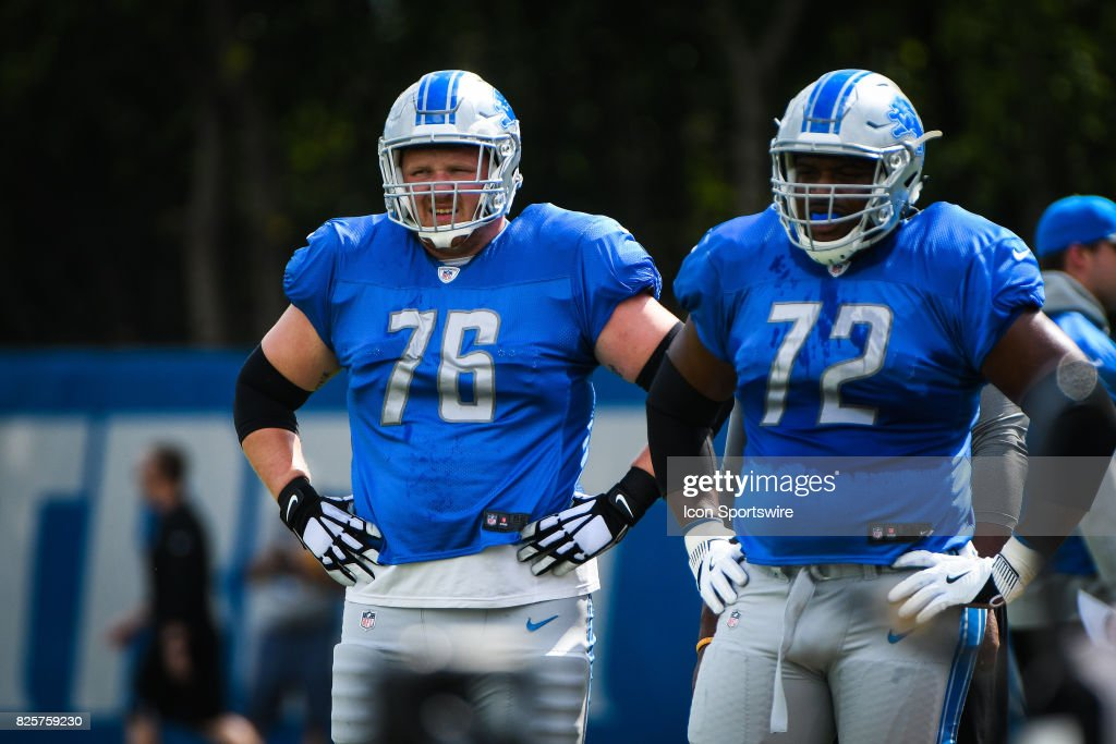 Detroit Lions offensive guard T.J. Lang (76) and Detroit Lions offensive guard Laken Tomlinson (72) wait for a drill during the Lions training camp workouts on August 2, 2017 at the Detroit Lions Training Facility in Allen Park, MI