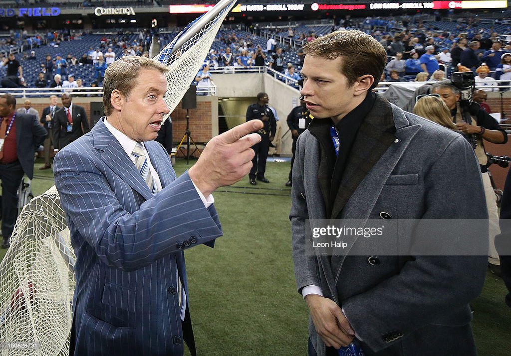 Detroit Lions owner and Chairman William Clay Ford (L) and 2012 Sprint Cup champion Brad Keselowski watch the pregame warm ups prior to the start of the game between the Houston Texans and the Detroit Lions at Ford Field on November 22, 2012 in Detroit, Michigan.