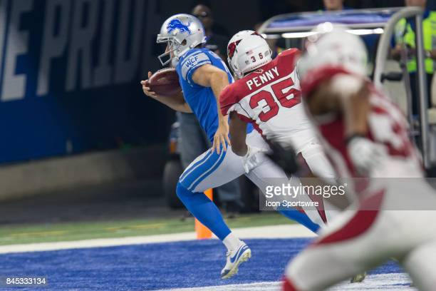 Detroit Lions punter Kasey Redfern tries to avoid being tackled in his end zone during first half game action between the Arizona Cardinals and the...