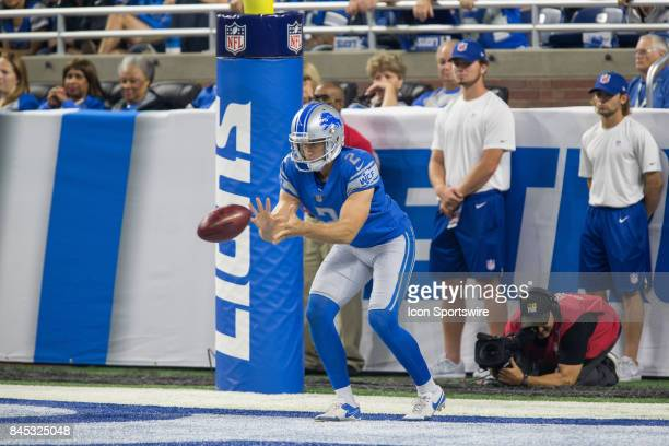 Detroit Lions punter Kasey Redfern tries to catch the snap while standing deep in his end zone during first quarter game action between the Arizona...