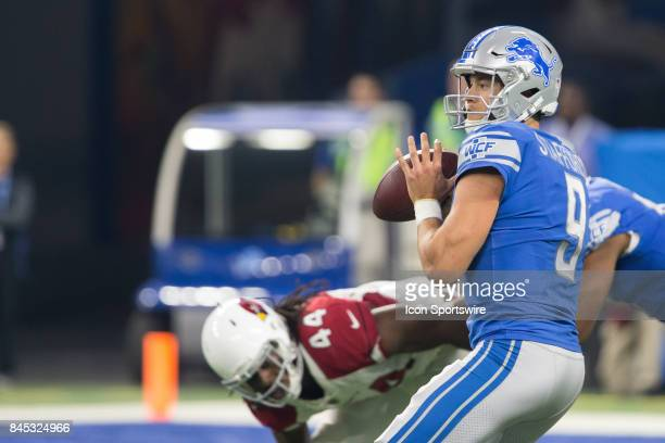Detroit Lions quarterback Matthew Stafford looks for an open receiver during first quarter game action between the Arizona Cardinals and the Detroit...