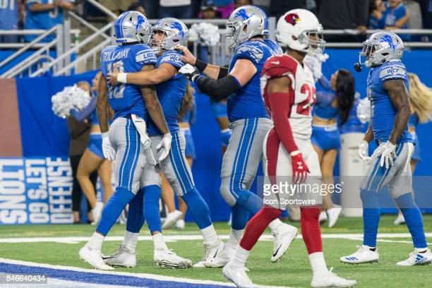 Detroit Lions quarterback Matthew Stafford right congratulates Detroit Lions wide receiver Kenny Golladay left for scoring a touchdown during game...