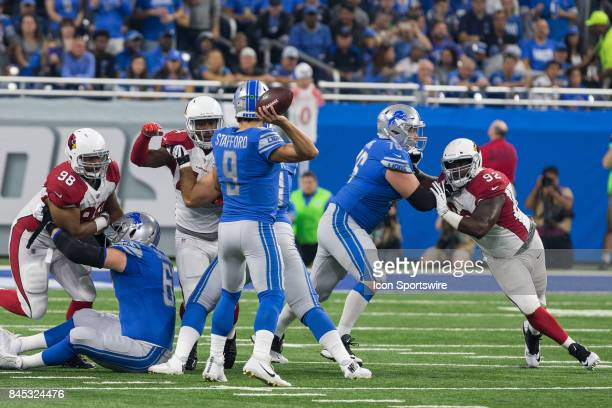 Detroit Lions quarterback Matthew Stafford throws a pass under pressure during first quarter game action between the Arizona Cardinals and the...