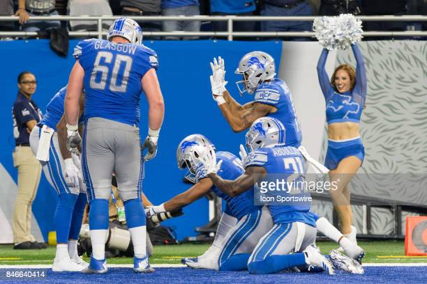 Detroit Lions running back Ameer Abdullah Detroit Lions wide receiver Golden Tate and Detroit Lions wide receiver Marvin Jones Jr bow down to Detroit...