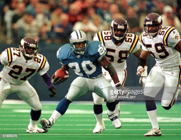 Detroit Lions running back Barry Sanders tries to outrun Minnesota Vikings defenders Corey Fuller Ed McDaniel and Dixon Edwards during the fourth...
