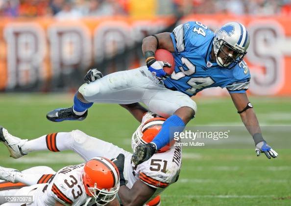 Detroit Lions Running Back Kevin Jones is upended by Cleveland's Chaun Thompson during their game Sunday October 23 2005 at Cleveland Browns Stadium...