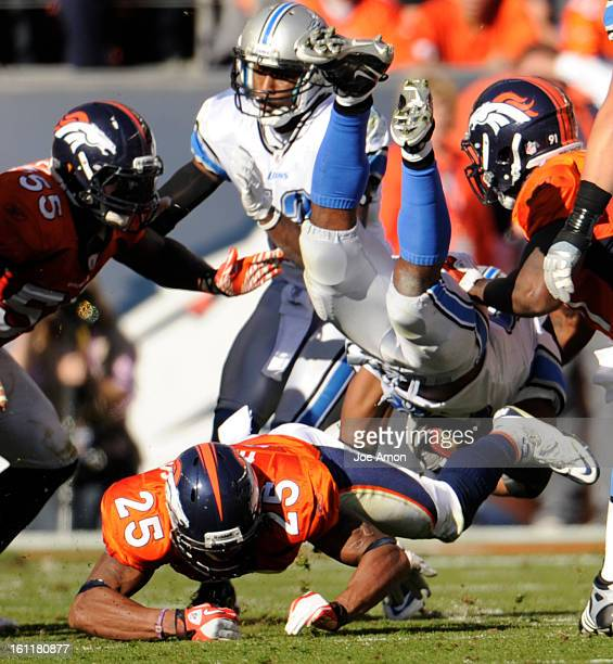 Detroit Lions running back Maurice Morris is upended by Denver Broncos defenders during the third quarter of play Sunday October 9 2011 Sports...