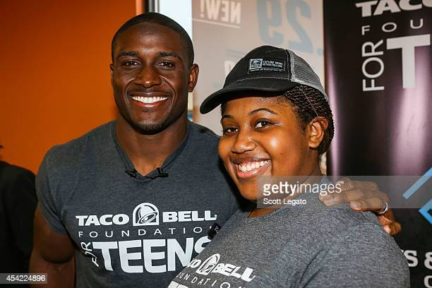 Detroit Lions running back Reggie Bush and $10000 scholarship winner Bria Gregory pose at the Touchdown For Teens Campaign at Taco Bell on August 26...