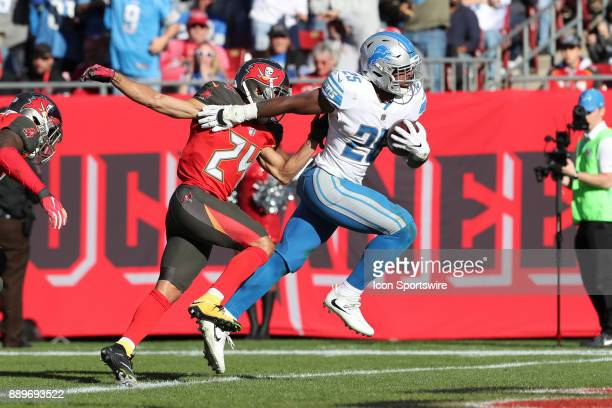 Detroit Lions running back Theo Riddick breaks a tackle from Tampa Bay Buccaneers cornerback Brent Grimes on his way into the end zone in the third...