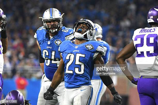 Detroit Lions running back Theo Riddick celebrates his long gain for a first down during the NFL football game between the Minnesota Vikings and...