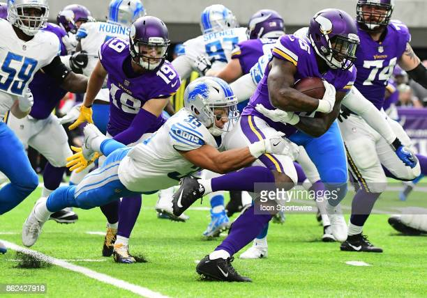 Detroit Lions safety Miles Killebrew wraps up Minnesota Vikings running back Latavius Murray during a NFL game between the Minnesota Vikings and...