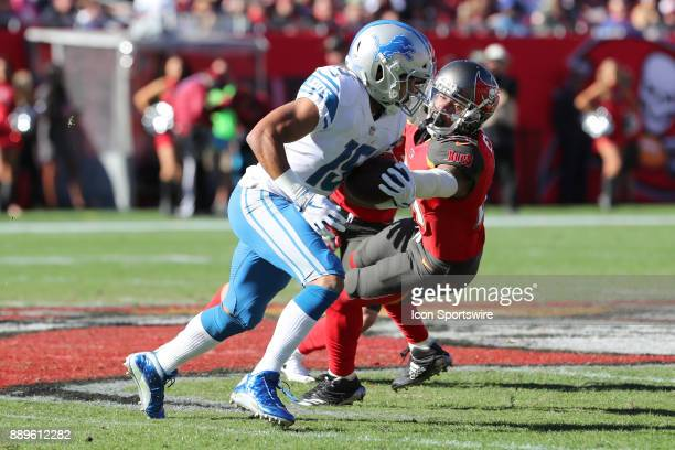 Detroit Lions wide receiver Golden Tate breaks a tackle from Tampa Bay Buccaneers strong safety Justin Evans in the second quarter of the NFL game...