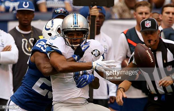 Detroit Lions' wide receiver Golden Tate is tackled by Indianapolis Colts' cornerback Patrick Robinson during the game between the Detroit Lions and...