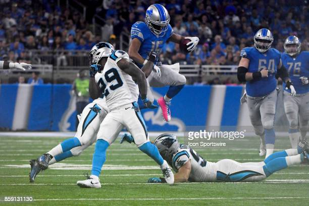 Detroit Lions wide receiver Golden Tate makes a catch in the middle of the field and hurdles a tackle during the Detroit Lions game versus the...
