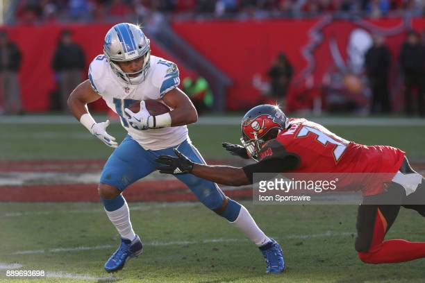 Detroit Lions wide receiver Golden Tate tries to break a tackle from Tampa Bay Buccaneers defensive back Robert McClain in the fourth quarter of the...