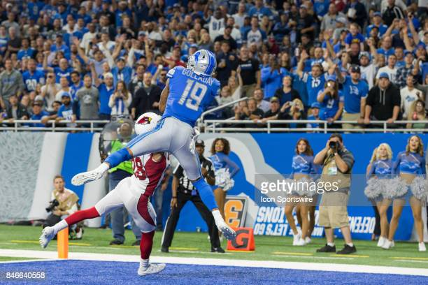 Detroit Lions wide receiver Kenny Golladay leaps into the air to catch a pass in the end zone for a touchdown over Arizona Cardinals corner back...
