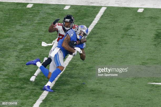 Detroit Lions wide receiver Kenny Golladay runs with the ball after catching a pass while Atlanta Falcons corner back Robert Alford makes the tackle...
