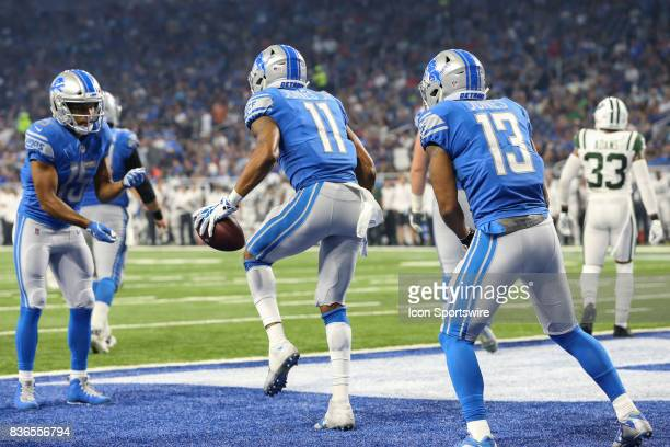Detroit Lions wide receiver Marvin Jones Jr celebrates scoring a touchdown in the endzone with Detroit Lions wide receiver Golden Tate and Detroit...