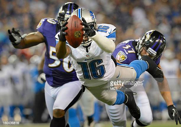 Detroit Lions wide receiver Titus Young dives of the end zone after making a reception and breaking a Ravens tackle in the first half of their...