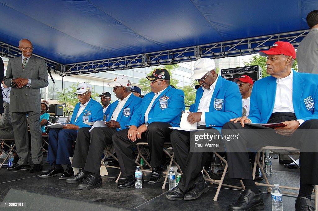 Detroit Mayor Dave Bing greets Tuskegee Airmen Alexander Jefferson, Burton C. Lowe, Arthur Green, Jesse Rutledge and Sandy G. Reid at the opening ceremony salute to the Airmen at the 2012 Detroit River Days Festival at the Detroit RiverWalk on June 22, 2012 in Detroit, Michigan.