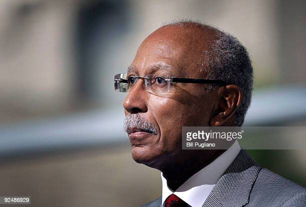 Detroit Mayor Dave Bing listens to White House Council on Auto Communities and Workers Executive Director Ed Montgomery speak at a press conference...