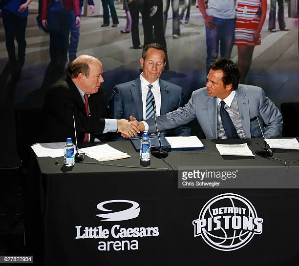 Detroit Mayor Mike Duggan shakes hands with Detroit Pistons owner Tom Gores during a press conference to announce that the Detroit Pistons will move...