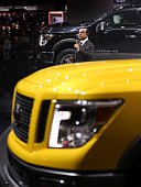 Detroit Michigan January 12 Carlos Ghosn unveils the new Titan pick up trucks from Nissan The North American International Auto Show opened to the...