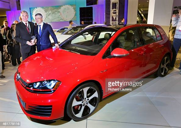 Detroit Michigan January 12 Dr HeinzJakob Neuser and Michael Horn with the car of the year the VW Golf The North American International Auto Show...