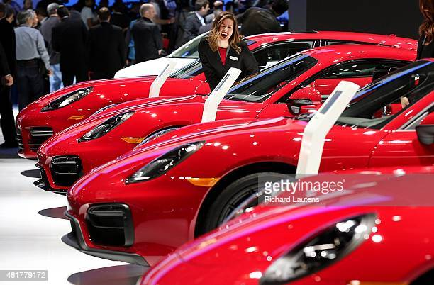 Detroit Michigan January 12 One of the models at Porsche has a laugh among the red cars The North American International Auto Show opened to the...