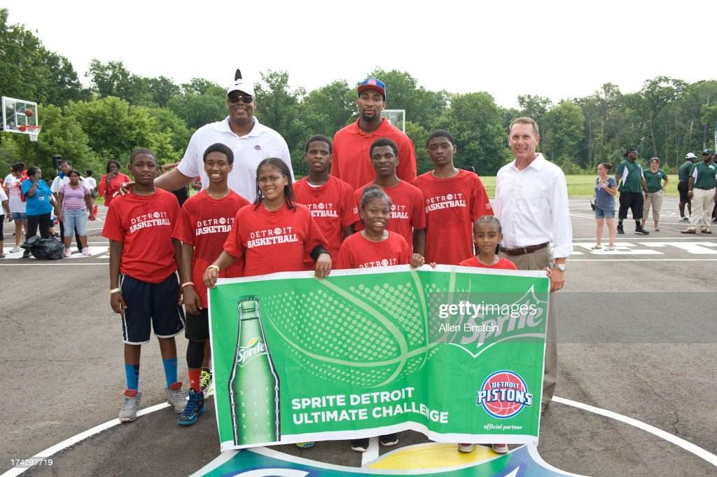 Detroit Piston, Andre Drummond #0 and Pistons Legend Rick Mahorn unveil renovated basketball courts as part of Metro Detroit Youth Day on July 17, 2013 at Belle Isle in Detroit, Michigan.