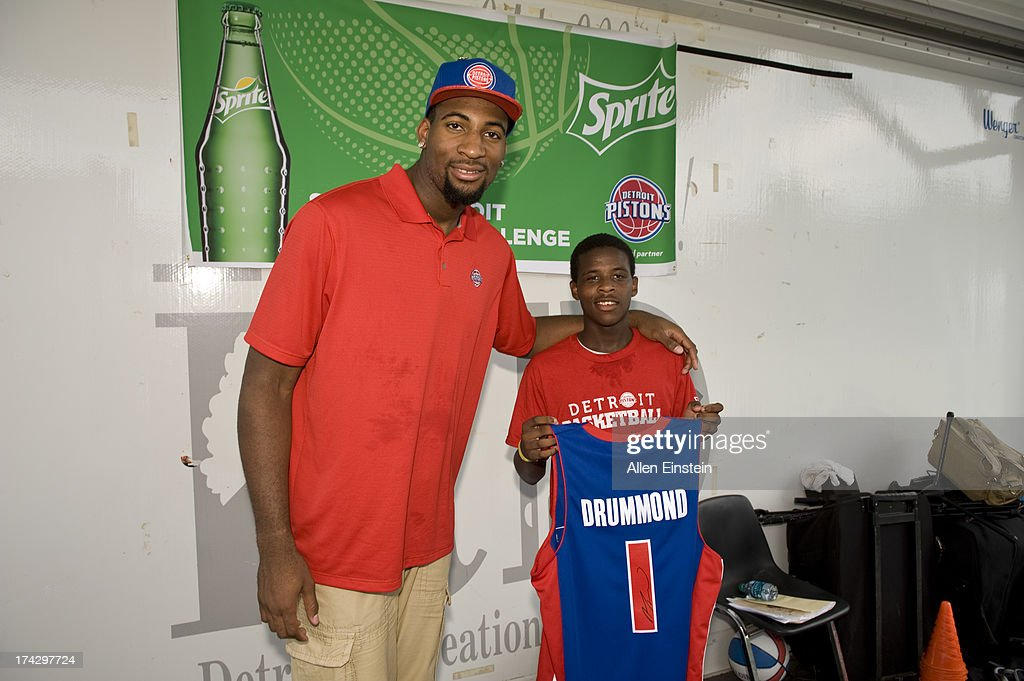 Detroit Piston, Andre Drummond #0 poses with a little boy after he signed his jersey for him. Also on hand was Pistons Legend Rick Mahorn unveil renovated basketball courts as part of Metro Detroit Youth Day on July 17, 2013 at Belle Isle in Detroit, Michigan.