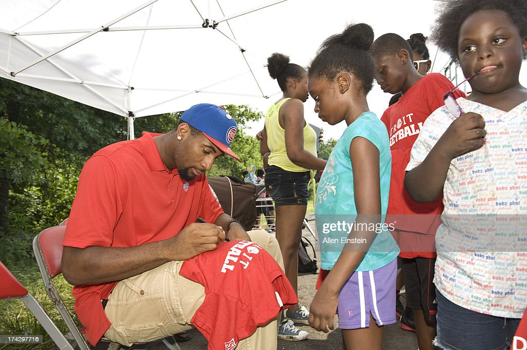 Detroit Piston, Andre Drummond #0 signs autographs for children. Also, Pistons Legend was Rick Mahorn was there to unveil renovated basketball courts as part of Metro Detroit Youth Day on July 17, 2013 at Belle Isle in Detroit, Michigan.
