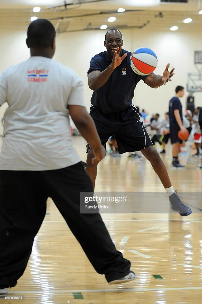 Detroit Pistons Assistant Coach Roy Rogers catches a pass from a participant during a NBA Cares Basketball Clinic as part of the 2013 NBA Draft Combine on May 18, 2013 at Quest Multiplex in Chicago, Illinois.