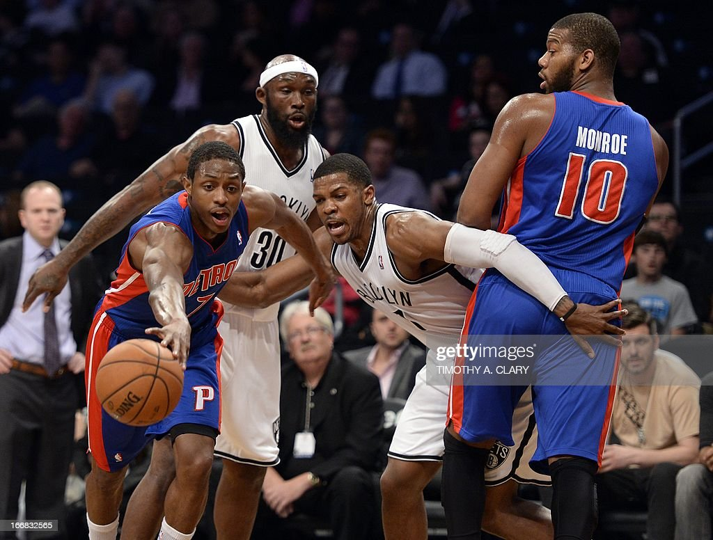 Detroit Piston's Brandon Knight (L) drives to the basket against Joe Johnson (2nd-R) of the Brooklyn Nets during their NBA game at the Barclays Center on April 17, 2013 in the Brooklyn borough of New York City. Piston's Greg Monroe (R) and Nets Reggie Evans (2nd-L) look on. AFP PHOTO / TIMOTHY A. CLARY