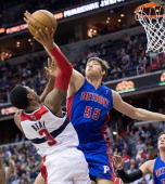 Detroit Pistons center Viacheslav Kravtsov blocks the shot of Washington Wizards shooting guard Bradley Beal during the second half of their game...