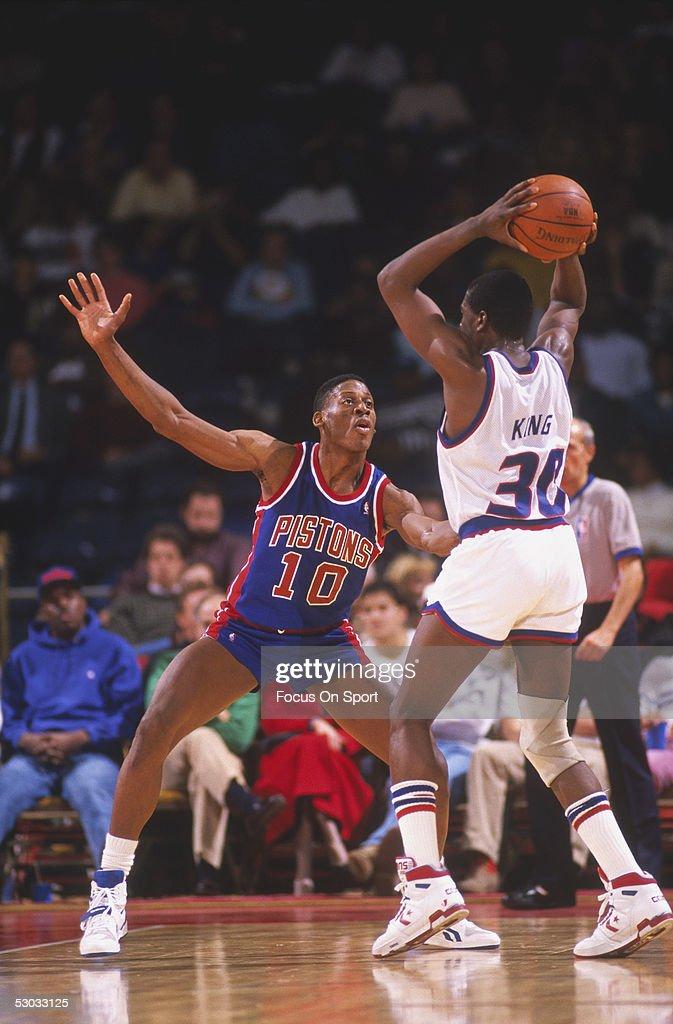 Detroit Pistons' forward Dennis Rodman guards against Washington Bullets' Bernard King at Capital Centre circa the 1990's in Washington DC NOTE TO...
