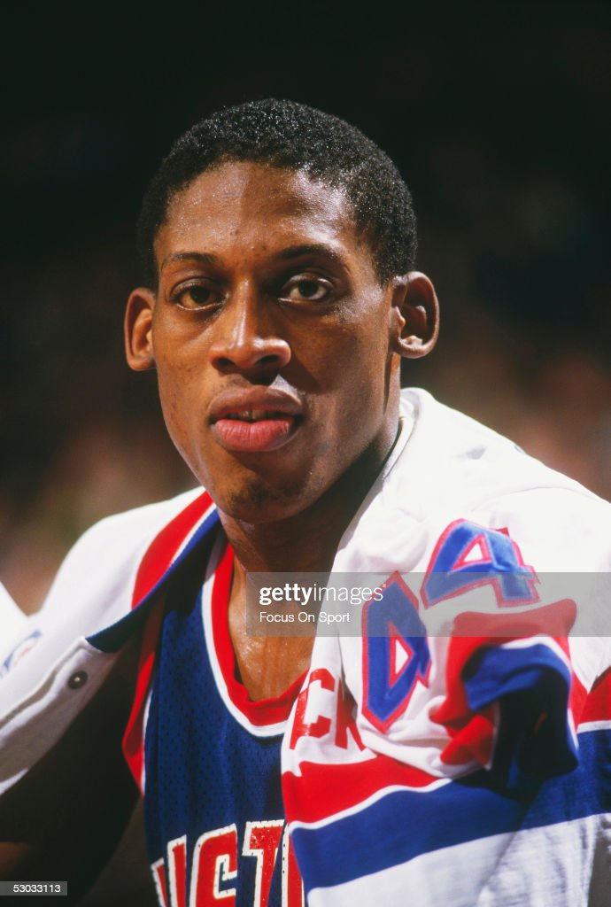 Detroit Pistons' forward Dennis Rodman sits on the bench during a game against the Washington Bullets at Capital Centre circa the 1990's in...