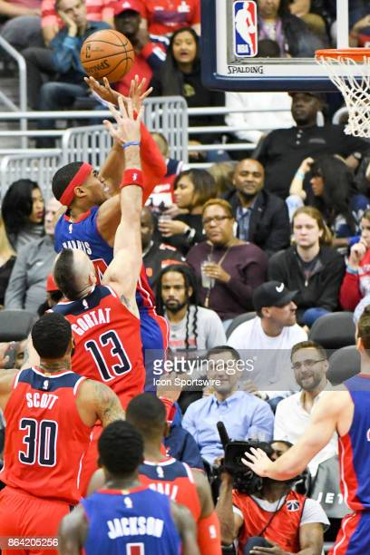 Detroit Pistons forward Tobias Harris is fouled by Washington Wizards center Marcin Gortat on October 20 2017 at the Capital One Arena in Washington...