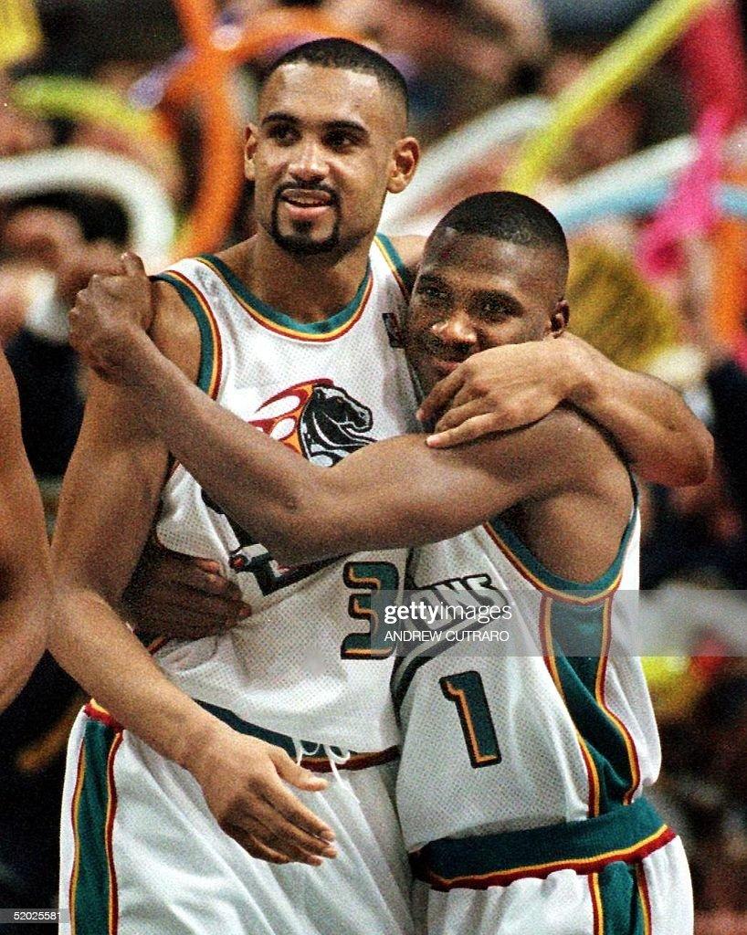 Detroit Pistons Grant Hill L embraces teammate