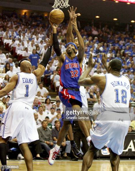 Detroit Pistons guard Richard Hamilton scores over Orlando Magic defenders Dwight Howard Maurice Evans and Rashard Lewis in Game 4 of the NBA Eastern...