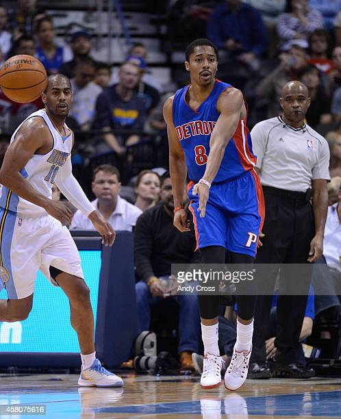 Detroit Pistons guard Spencer Dinwiddie right dishes the ball off to a teammate against Denver Nuggets guard Arron Afflalo in the first half at the...