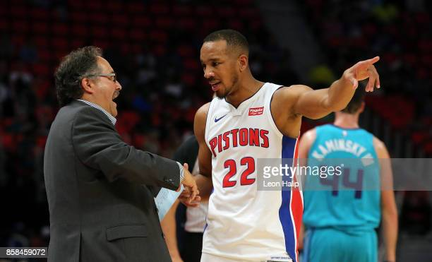 Detroit Pistons head coach Stan Van Gundy talks with Avery Bradley during the second quarter of the preseason game against the Charlotte Hornets at...
