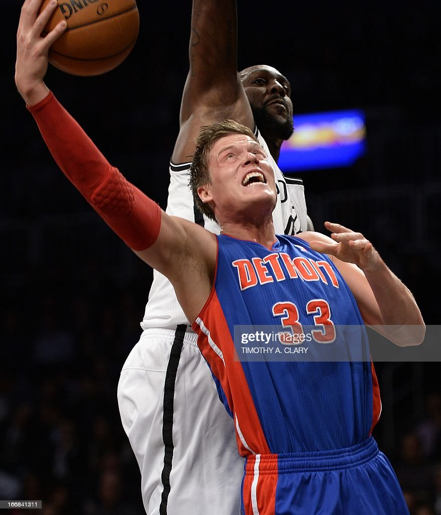 Detroit Pistons Jonas Jerebko (FRONT) drives against the Brooklyn Nets Andray Blatche during their NBA game at the Barclays Center on April 17, 2013 in the Brooklyn borough of New York City. AFP PHOTO / TIMOTHY A. CLARY