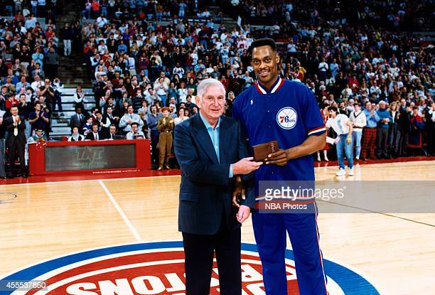 Detroit Pistons owner Bill Davidson celebrates with Rick Mahorn during a Detroit Pistons game circa 1990 at The Palace of Auburn Hills in Auburn...