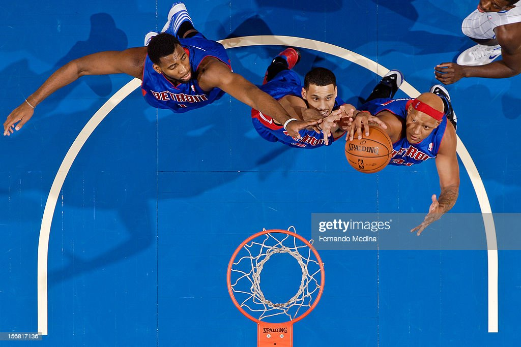 Detroit Pistons players Andre Drummond #1, Austin Daye #5 and Charlie Villanueva #31 jump for a rebound against the Orlando Magic on November 21, 2012 at Amway Center in Orlando, Florida.