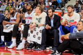 Detroit Pistons players from left Greg Monroe Andre Drummond Kyle Singler Jose Calderon and Viacheslav Kravtsov look on from the bench during a game...