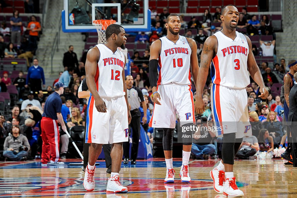Detroit Pistons players, from left, Will Bynum #12, Greg Monroe #10, and Rodney Stuckey #3 walk to the sideline during a timeout against the Charlotte Bobcats on January 6, 2013 at The Palace of Auburn Hills in Auburn Hills, Michigan.