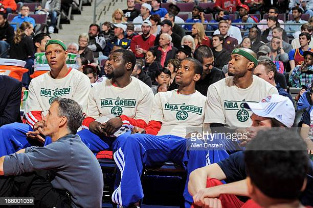 Detroit Pistons players wearing NBA Green Week Tshirts from left Charlie Villanueva Will Bynum Kim English and Corey Maggette look on from the bench...